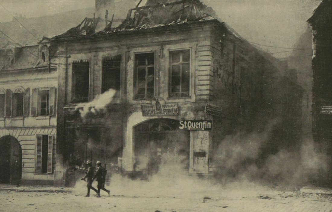 Cambrai as the Germans retreated - Canadian troops among the blazing buildings in Cambrai, France.