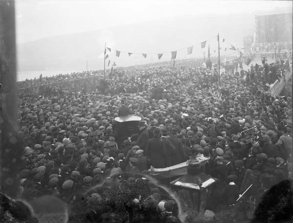The passage of Home Rule in 1914 is as certain 'as the spring will succeed the winter gloom', John Redmond has told a nationalist rally in Waterford. Here, in a photograph from 1913, he  addresses an equally large crowd at the opening of a new bridge, also in his home constituency.