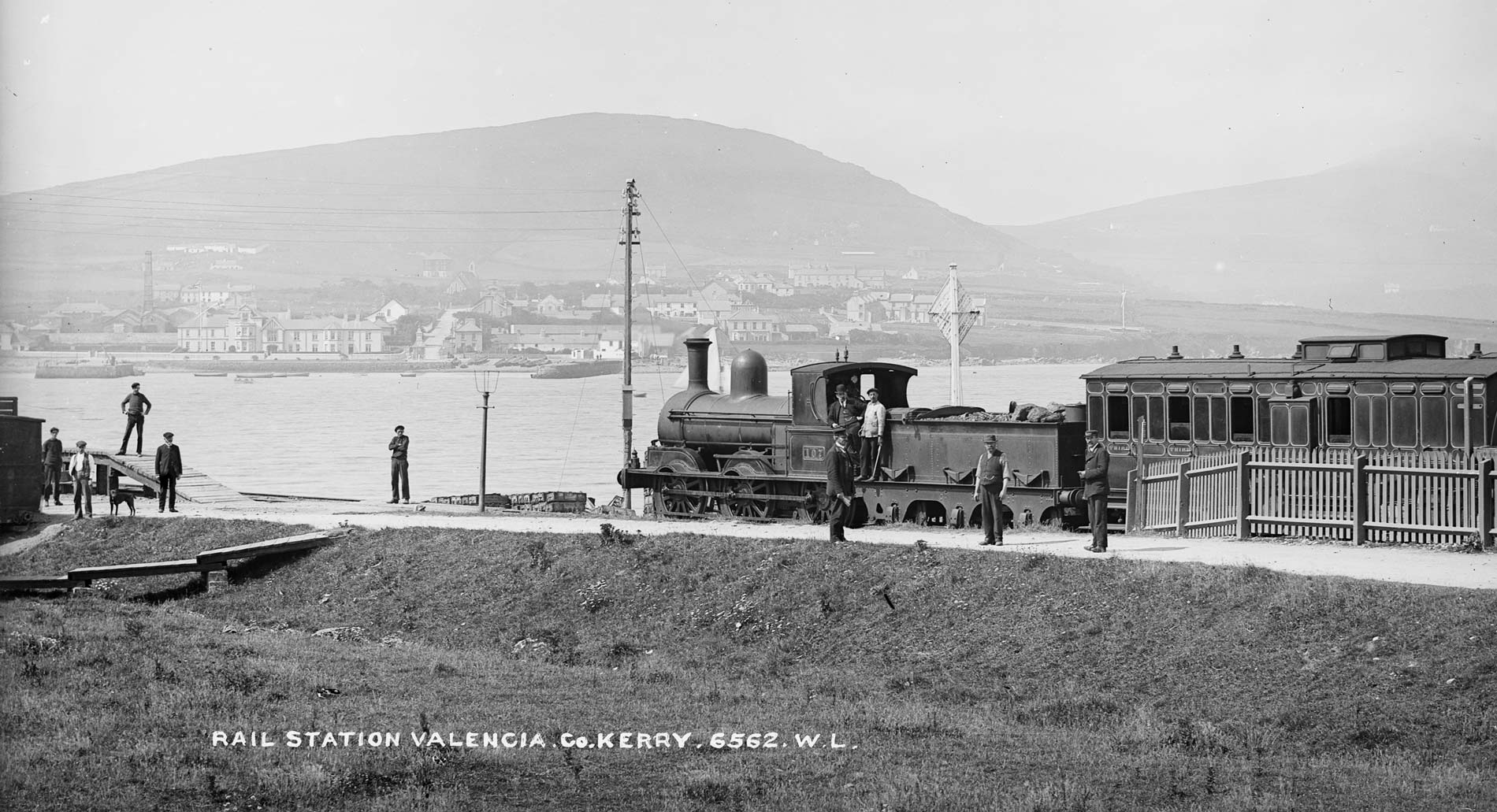 Locomotive 107 at Valentia (Valencia) Harbour Station in Co. Kerry between 1901 and 1908. The line was served by the Great Southern and Western Railway